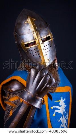 Studio shot of powerful knight - stock photo