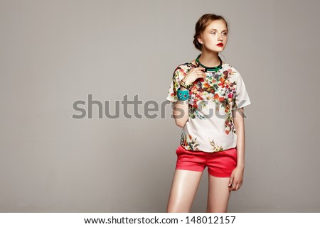 studio shot of pretty fashion model on grey background  - stock photo