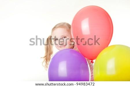 studio shot of pretty  little girl with balloons - stock photo