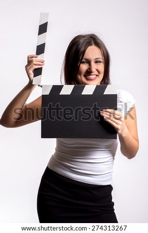 Studio shot of pretty yooun woman with clapboard - stock photo