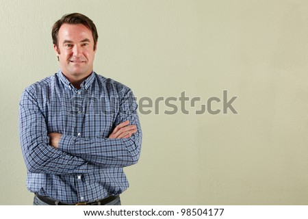 Studio Shot Of Relaxed Middle Aged Man - stock photo