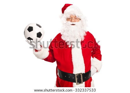 Studio shot of Santa Claus holding a football and looking at the camera isolated on white background - stock photo