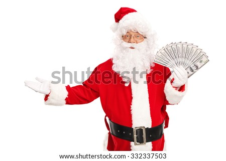 Studio shot of Santa Claus holding a spread of money and gesturing with his hand isolated on white background - stock photo