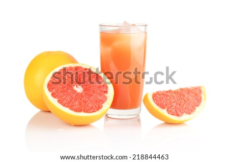 Studio shot of sliced three grapefruits with grapefruit juice with ice cubes isolated white background - stock photo