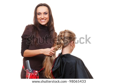 studio shot of smiley hairdresser doing a plait. white background - stock photo