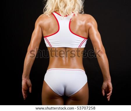 Studio shot of sportswoman's body - stock photo