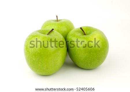 studio shot of three green apples - stock photo