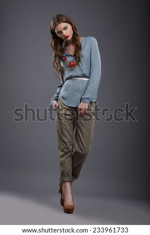 Studio Shot of Trendy Fashion Model in Pants and Blouse - stock photo
