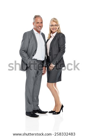Studio shot of two business colleagues standing together looking at camera smiling over white background - stock photo