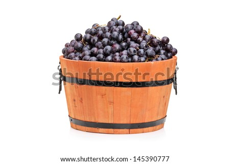 Studio shot of wine grape in a wooden barrel isolated on white background - stock photo