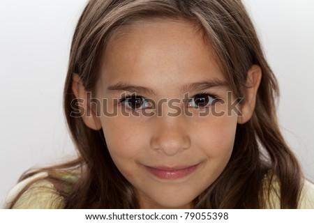 Studio shot of 7 year old brunette girl on white background - stock photo