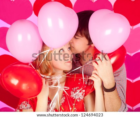 studio shot of young couple in love, over colorful background - stock photo