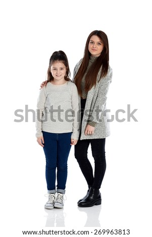 Studio shot of young girls standing together looking at camera on white background - stock photo