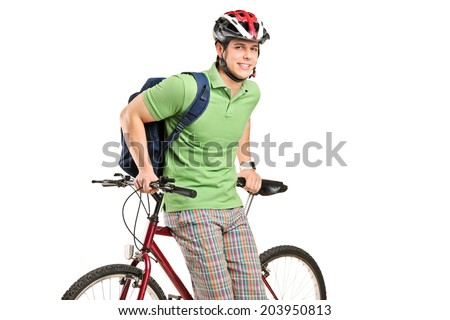 Studio shot of young man with a backpack and bike isolated on white background - stock photo