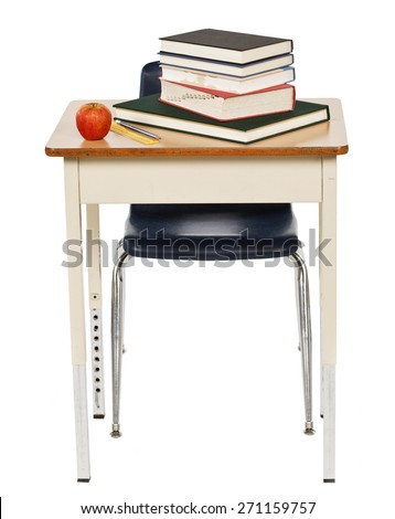 Studio shot on white background of an old metal school desk and chair with books and an apple on it. - stock photo