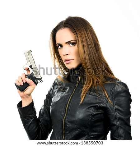 studio shot on white background: young beauty woman holding .44 Magnum handgun, ready to fight - stock photo