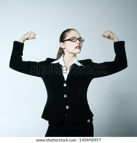 studio shot portrait of one caucasian young woman  feeling strong - stock photo