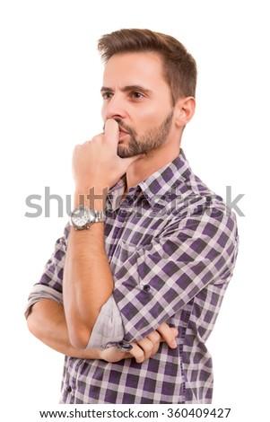 Studio shot: Young man having a great idea - stock photo