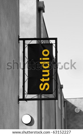 Studio sign: Studio sign on the side of a building. Partly desaturated image. - stock photo