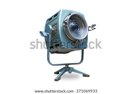 Studio spotlight lighting equipment with stand. Electrical source of constant light, cyan color, with traces of use and some rust, halogen bulb. Isolated on white background, clipping path included. - stock photo