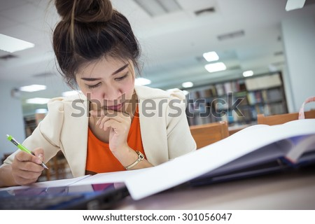 study education, woman worked in the library - stock photo