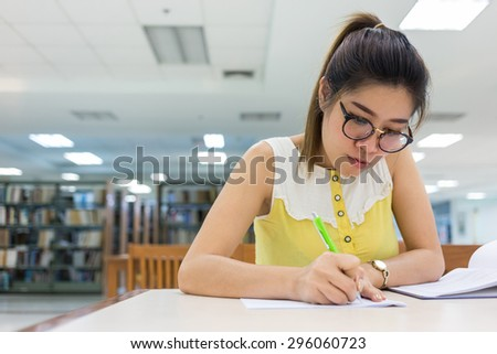 study education, woman writing a paper, working women - stock photo