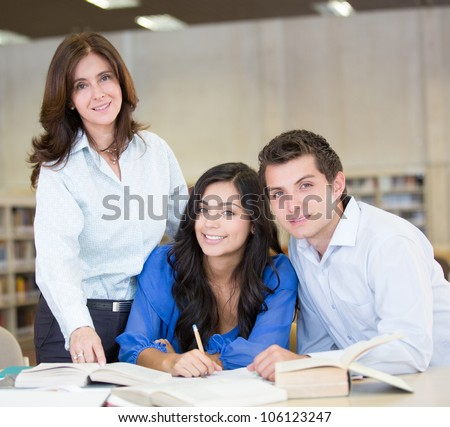 Study group at the library with an advisor - stock photo