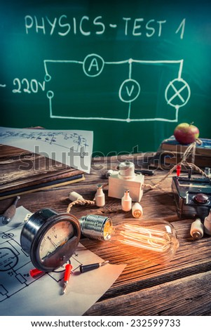 Study of electric current in the physics laboratory - stock photo