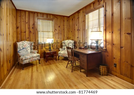 study with wood walls and oak floors - stock photo