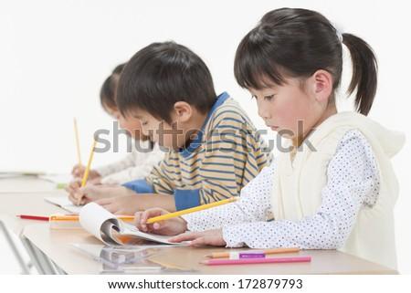 Studying children - stock photo