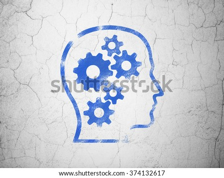 Studying concept: Head With Gears on wall background - stock photo