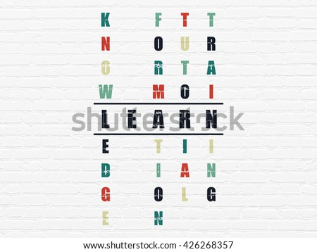 Studying concept: Painted black word Learn in solving Crossword Puzzle - stock photo