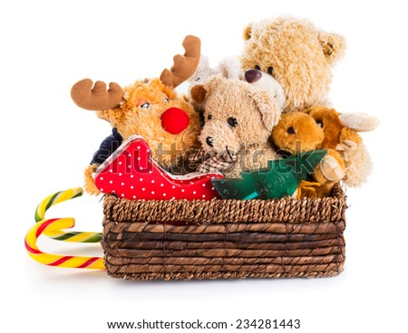 Stuffed animal toys in a christmas sledge isolated on a white background  - stock photo