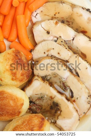 Stuffed chicken breast with roast potatoes and carrots. - stock photo