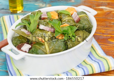 Stuffed Collard Greens. Collard Greens Stuffed Rolls with ground meat, rice and spices.  Macro, selective focus - stock photo