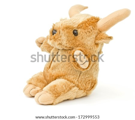 stuffed cow on a white background - stock photo