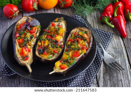 Stuffed eggplant with fried vegetables - stock photo