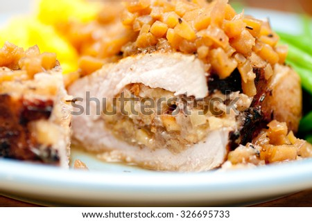 stuffed organic, heritage pork chop stuffed with diced apple and mushroom with squash and beans - stock photo