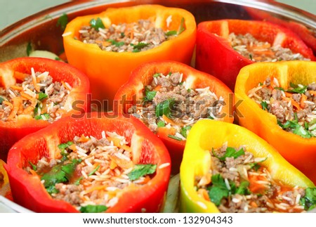stuffed peppers in pot ready for cooking - stock photo