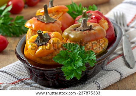Stuffed peppers minced chicken with carrots with tomato sauce - stock photo