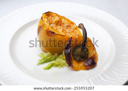 Stuffed peppers with rice, carrots, tomatoes, onions and spices.Vegeterian food - stock photo