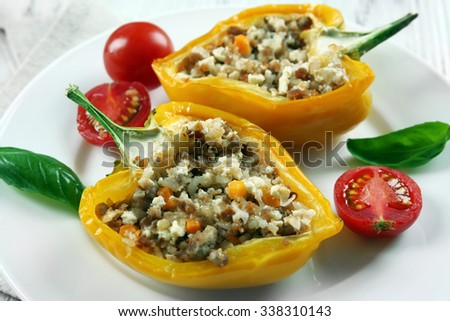 Stuffed peppers with vegetables on table close up - stock photo