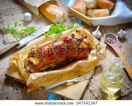 Stuffed Pork Loin Roast on the board. - stock photo