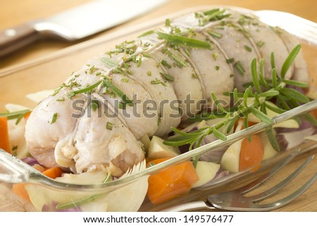 Stuffed Raw Capon in Glass Roasting Tray Non sharpen file - stock photo