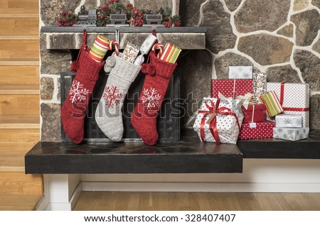 Stuffed stockings hanging on a fireplace on christmas morning  - stock photo