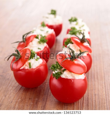 stuffed tomato with cheese - stock photo