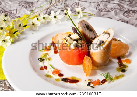Stuffed Tomato with Chicken Roll. Photo, picture - stock photo