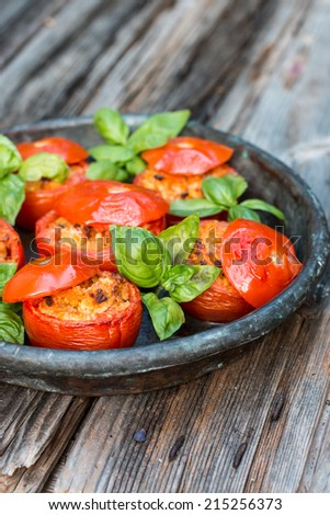 Stuffed tomatoes on the rustic dish - stock photo