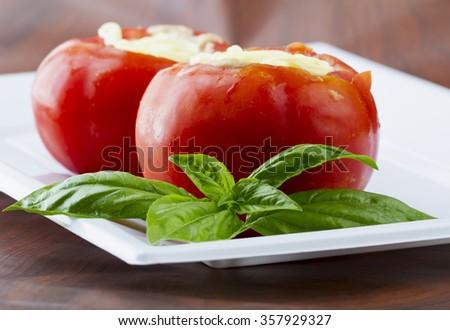 Stuffed tomatos over white plate, horizontal image - stock photo