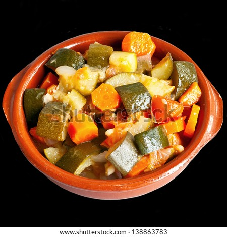 Stuffed vegetables in ceramic bowl isolated over black background - stock photo